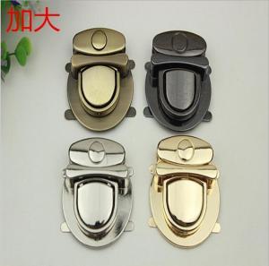 China Fashionable handbag hardware zinc alloy nickel color metal push lock for bags wholesale