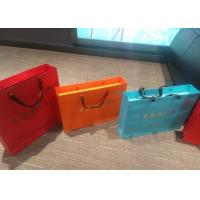 China Fashion Colored Paper Gift Bags With Handles Customized Size And Color wholesale