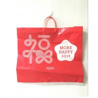China HPPE Rigid Handle Custom Plastic Shopping Bags Red Color New Year Printed on sale