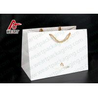 China Hot Foil Stamping Christmas Gift Custom Printed Paper Bags Eco Friendly Feature on sale