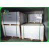 China 53gsm Woodfree Paper Grade A Long Grane 70 * 100cm High Brightness Reams wholesale