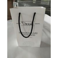 China Promotional Printed Paper Shopping Bags , Printed White Paper Bags With Handles wholesale