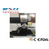 China 10W 20W 30W Fiber Laser Automatic Laser Marking Machine With Moving Work Table on sale