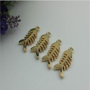 China Small light gold fish bones pattern zinc alloy metal handbag logo label tags for sales wholesale