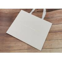 China Degradable Cloth Carrying Kraft Paper Packaging Bags With Hot Stamped Logo wholesale