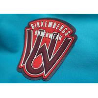 Custom Logo Embossed Self Adhesive Clothing Patches , Silicone Garment Patch 3D Rubber Clothing Labels Manufactures