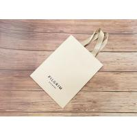 China Handmade Luxury Kraft Shopping Bags With Matching Color Strong Silk Fabric Handle wholesale
