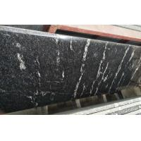 China Different Color Control Natural Stone Slabs Black Granite With White Vein Material wholesale