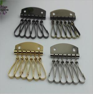 China Fashion Style Leather Key Chain Zipper Card Wallet Unisex Iron gold Keychain Holder with 6 Hooks Snap Closure wholesale