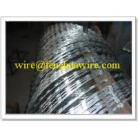 China concertina pvc coated /razor wire barbed tape on sale
