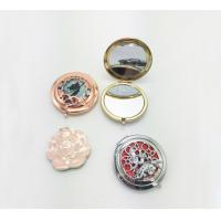 China Professional Metal Souvenir Girls Round Portable Makeup Mirror With Flower Engraved wholesale