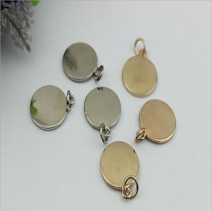 China Handbag hardware metal round shape flat logo label tag plate with light gold wholesale