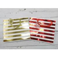 China Stripes Exquisite  Recycled Paper Gift Bags Luxury Metallic Foil Logo Gold Ribbon Handle on sale