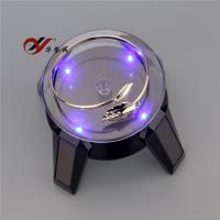 China Round Rotating Jewelry Display Stand , Black / White Solar Rotating Stand With Long Leg wholesale