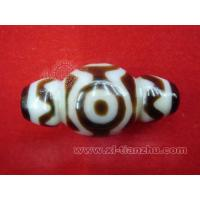 China Four-eyed Dzi with Tiger-tooth Motif on sale