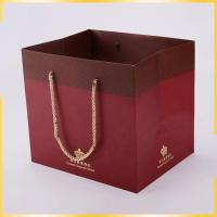 China wholesale cheap kraft shopping gift paper bags with nylon handles wholesale