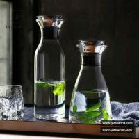 China Heat Resistant Glassware Borosilicate Water Carafe Glass Pitcher with Stainless Steel Flow Lid on sale